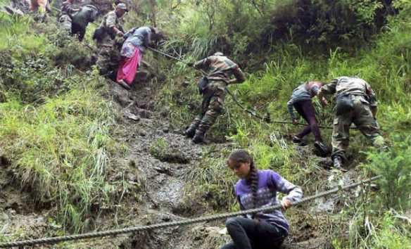 Army soldiers rescuing pilgrims during their flood relief operation in Chamoli, Uttarakhand